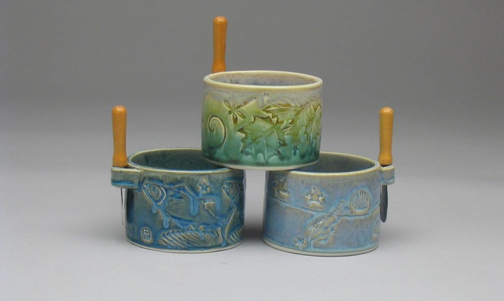 Three handmade porcelain pate bowls