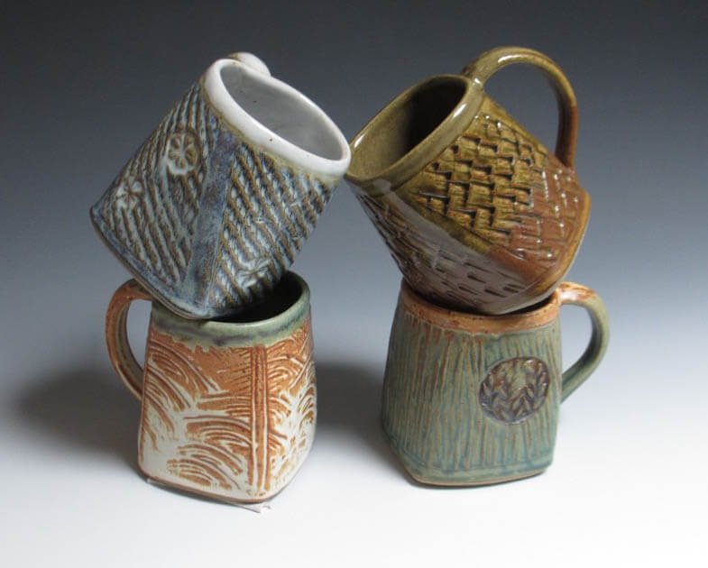 Four handmade porcelain mugs