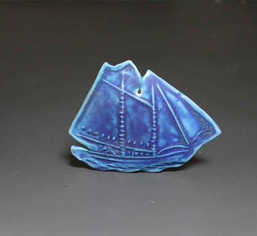 dark blue sailboat ornament