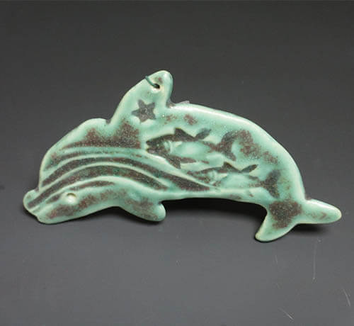 Green dolphin ornament