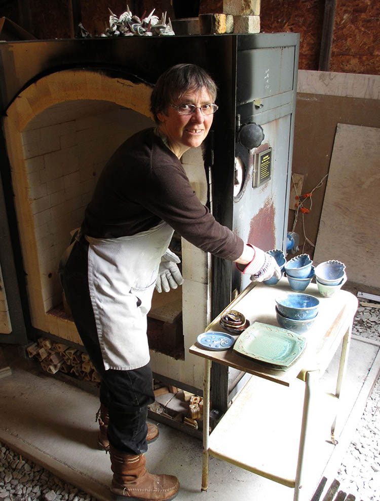 Nancy Button working in the pottery studio